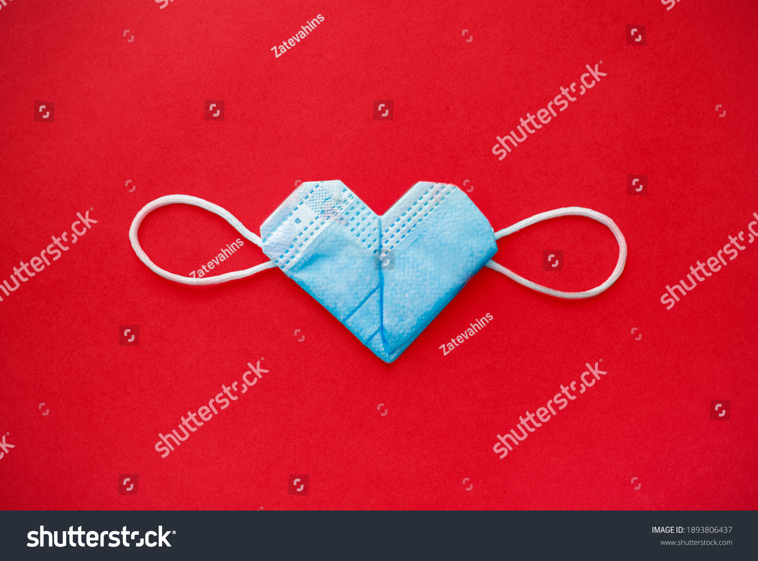 valentine's day during the coronavirus covid pandemic, 14 February 2021. medical mask valentine #1893806437