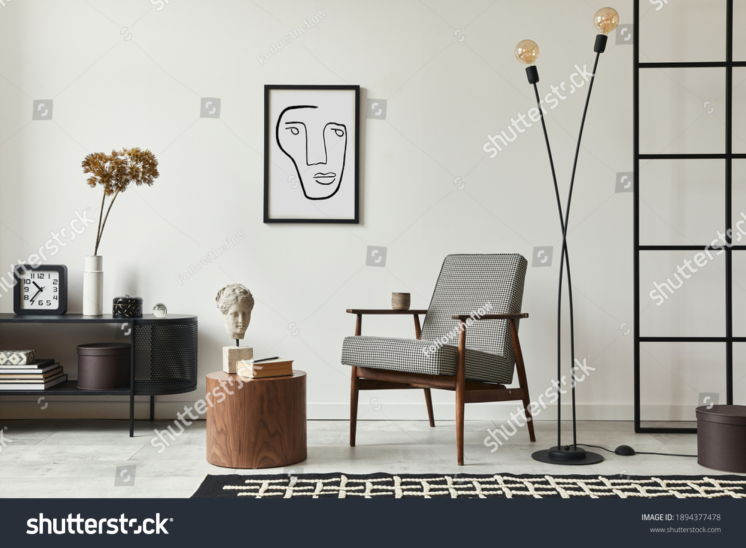 Stylish scandinavian composition of living room with design armchair, black mock up poster frame, commode, wooden stool, book, decoration, loft wall and personal accessories in modern home decor. #1894377478