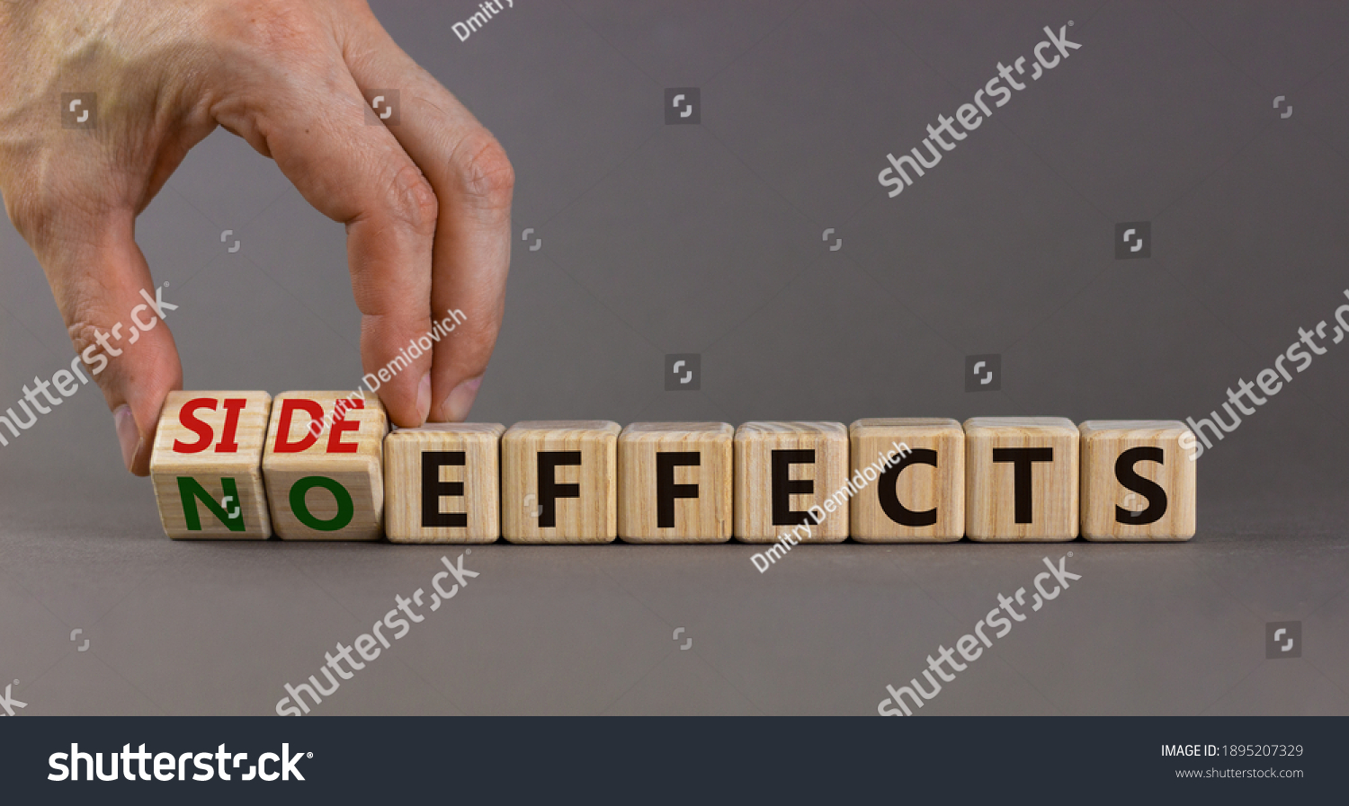 Side or no effects symbol. Hand turns wooden cubes and changes words 'no effects' to 'side effects'. Beautiful grey background, copy space. Medical, covid-19 pandemic corona side effects concept. #1895207329