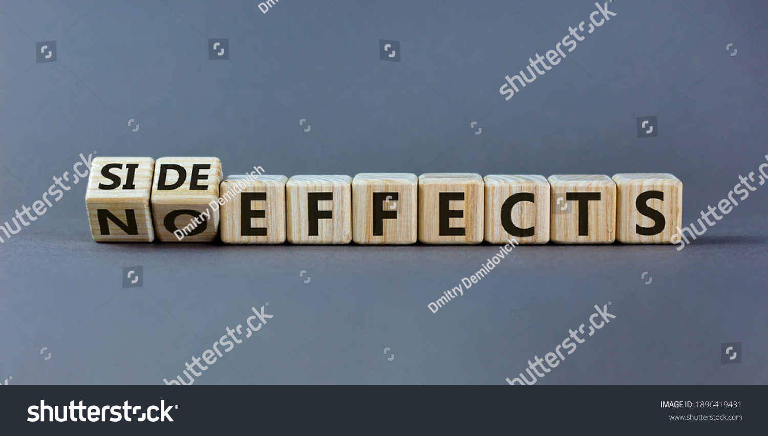 Side or no effects symbol. Turned wooden cubes and changed words 'no effects' to 'side effects'. Beautiful grey background, copy space. Medical, covid-19 pandemic corona side effects concept. #1896419431