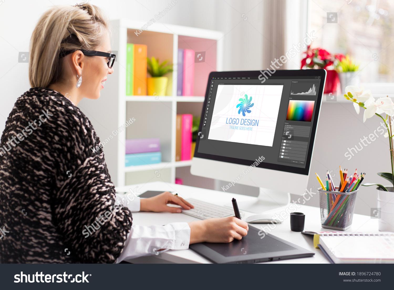 Graphic design artist working on client's logo design #1896724780