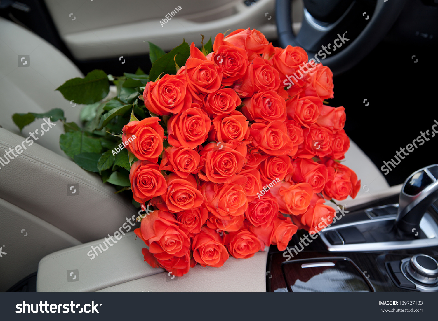 Bouquet beautiful red roses luxury car stock photo royalty free bouquet of beautiful red roses in luxury car composition for a romance or anniversary izmirmasajfo