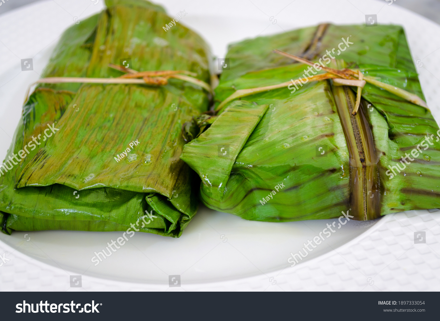 Closeup of fish covered and fried in banana leaf in traditional Kerala style (Meen Pollichathu)