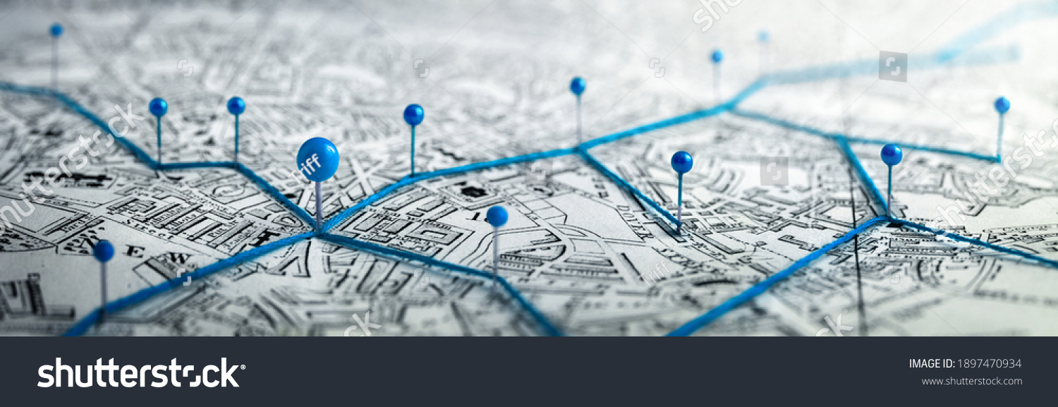 Routes with blue pins on a city map. Concept on the  adventure, discovery, navigation, communication, logistics, geography, transport and travel topics. #1897470934