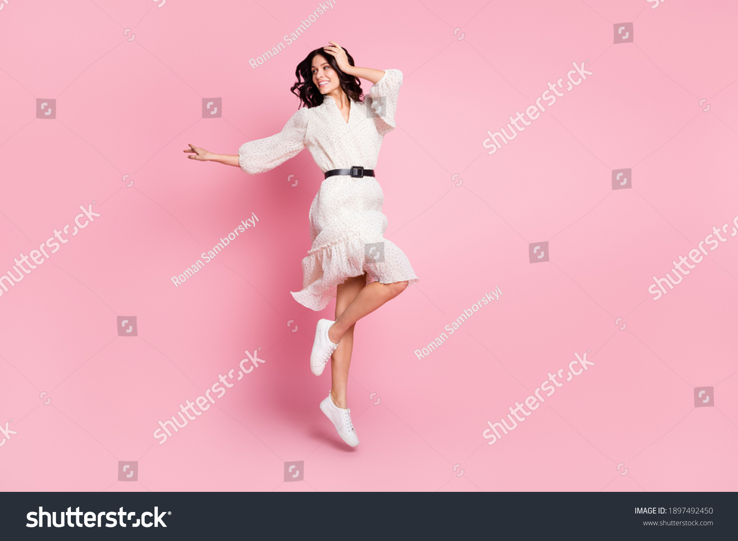 Full length body size photo of cheerful woman in long dress jumping looking empty space isolated pastel pink color background #1897492450