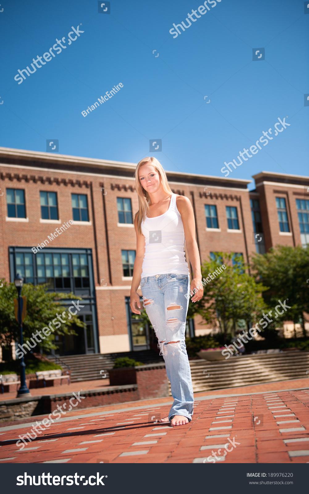 https://image.shutterstock.com/shutterstock/photos/189976220/display_1500/stock-photo-casual-young-woman-walking-barefoot-through-urban-setting-189976220.jpg