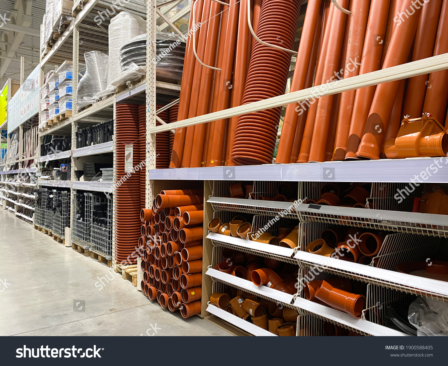 Assortment of a hardware store, pipes. Building materials and manufactured goods are stacked and put up for sale in a hardware store #1900588405