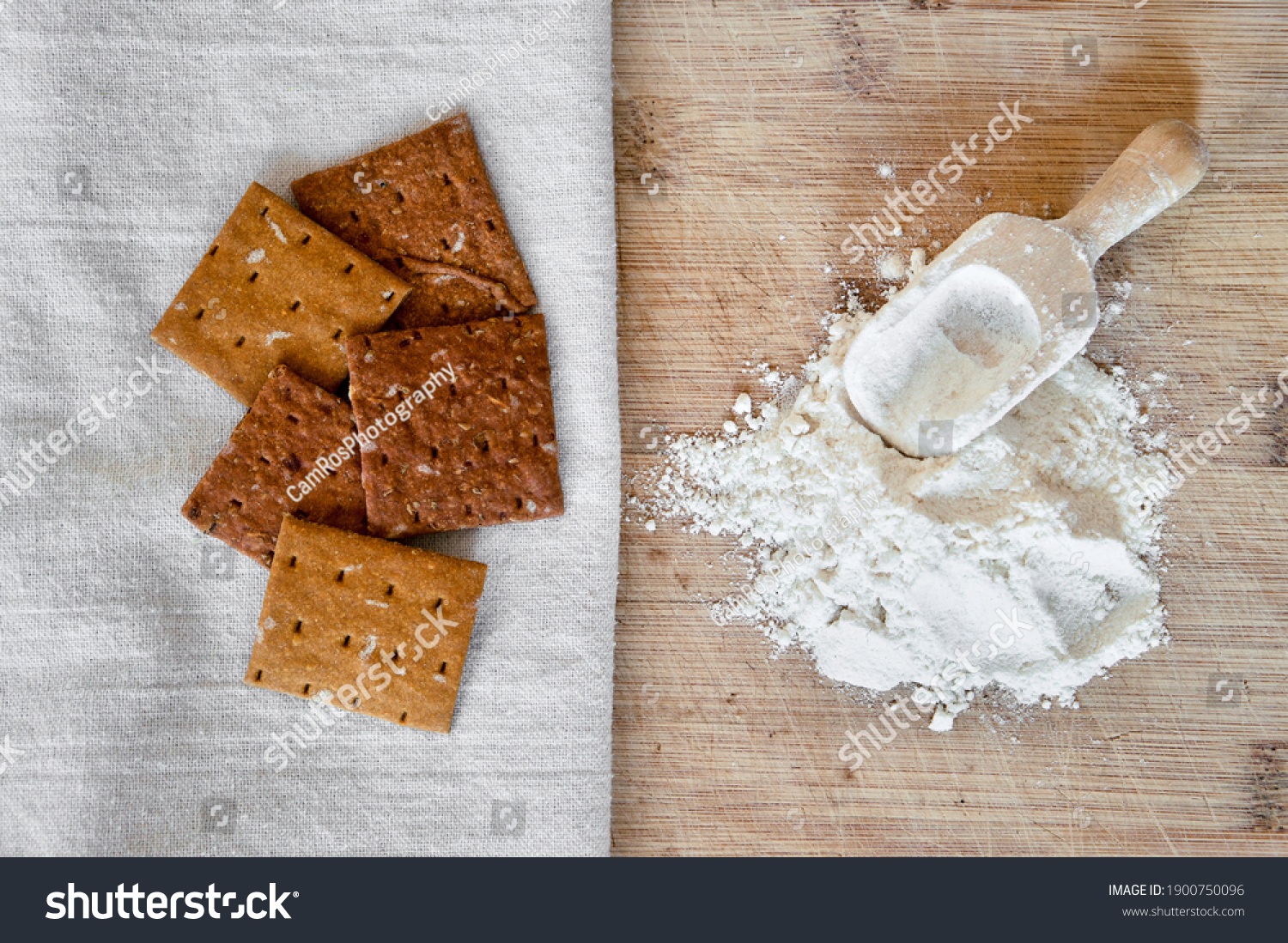 Cricket insect crackers snack and cricket flour for eating as food items made of cooked insects as a good source of protein. Entomophagy concept. The concept of protein food sources from insects. #1900750096