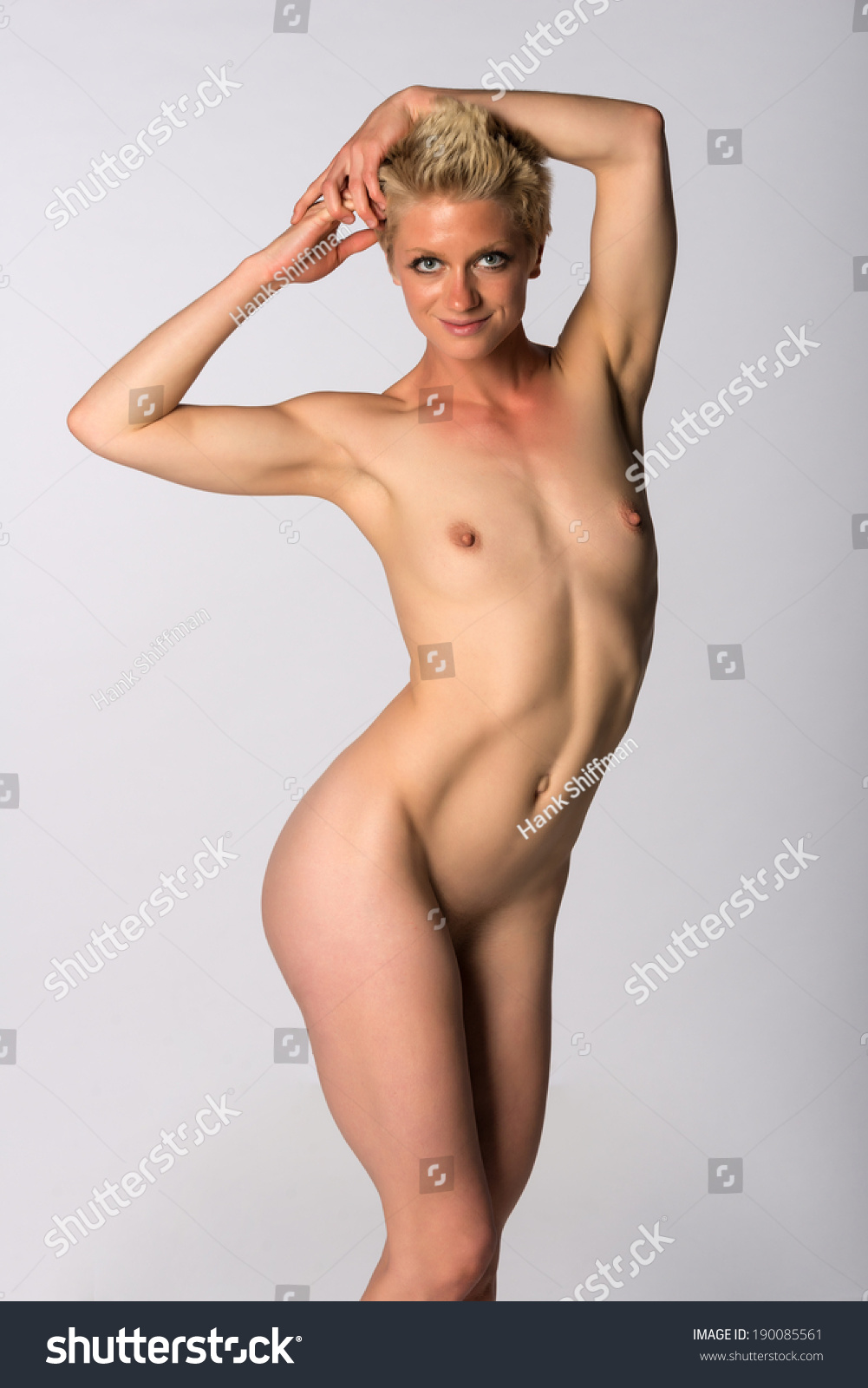 athletic woman nude Pretty athletic blonde woman nude on gray