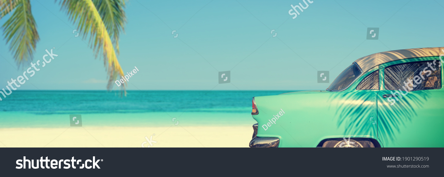 Classic car on a tropical beach with palm tree, panoramic vintage summer background #1901290519