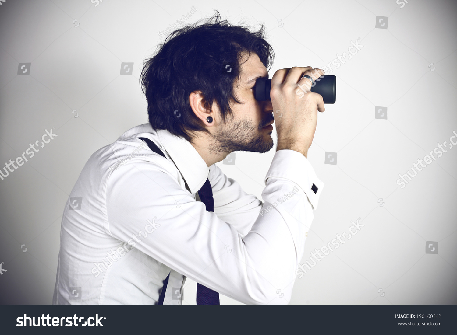 Young businessman spying  #190160342