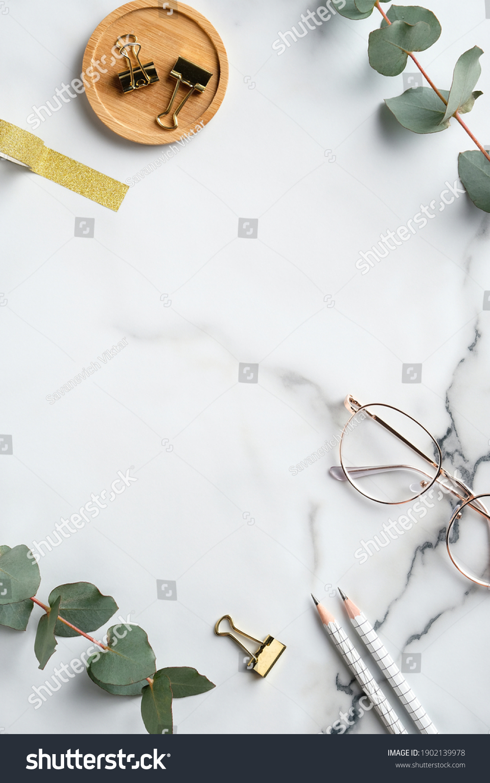 Flat lay home office desk table. Feminine workspace with glasses, office supplies, greenery on marble background. Elegant freelancer workplace #1902139978