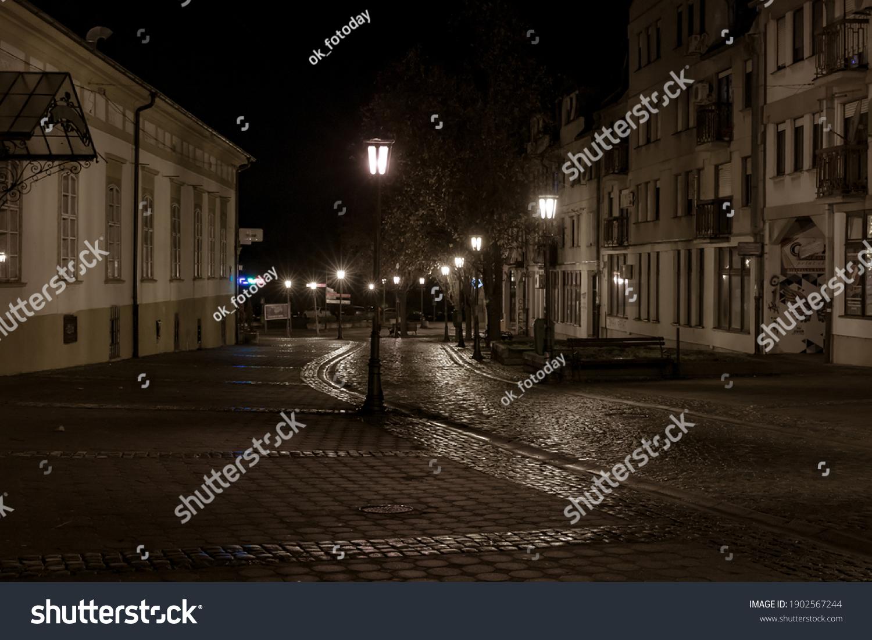 The popular pedestrian street Nikola Tesla on a cool winter evening after rain. Serbia, Pancevo, January 24, 2021