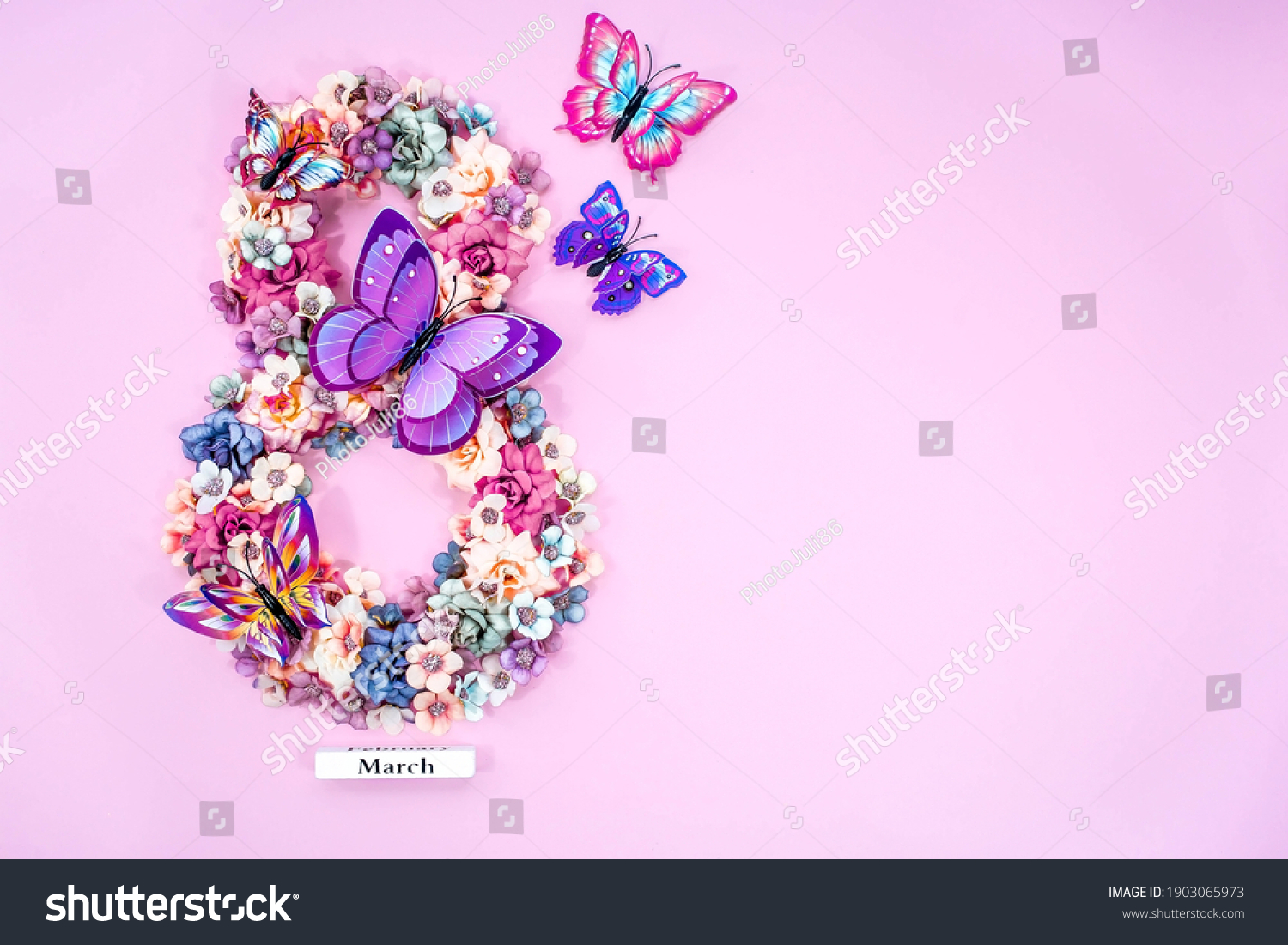 International Women's Day. Banner, flyer, beautiful postcard for March 8. Flowers and butterflies in the shape of the number eight on a pink background. #1903065973