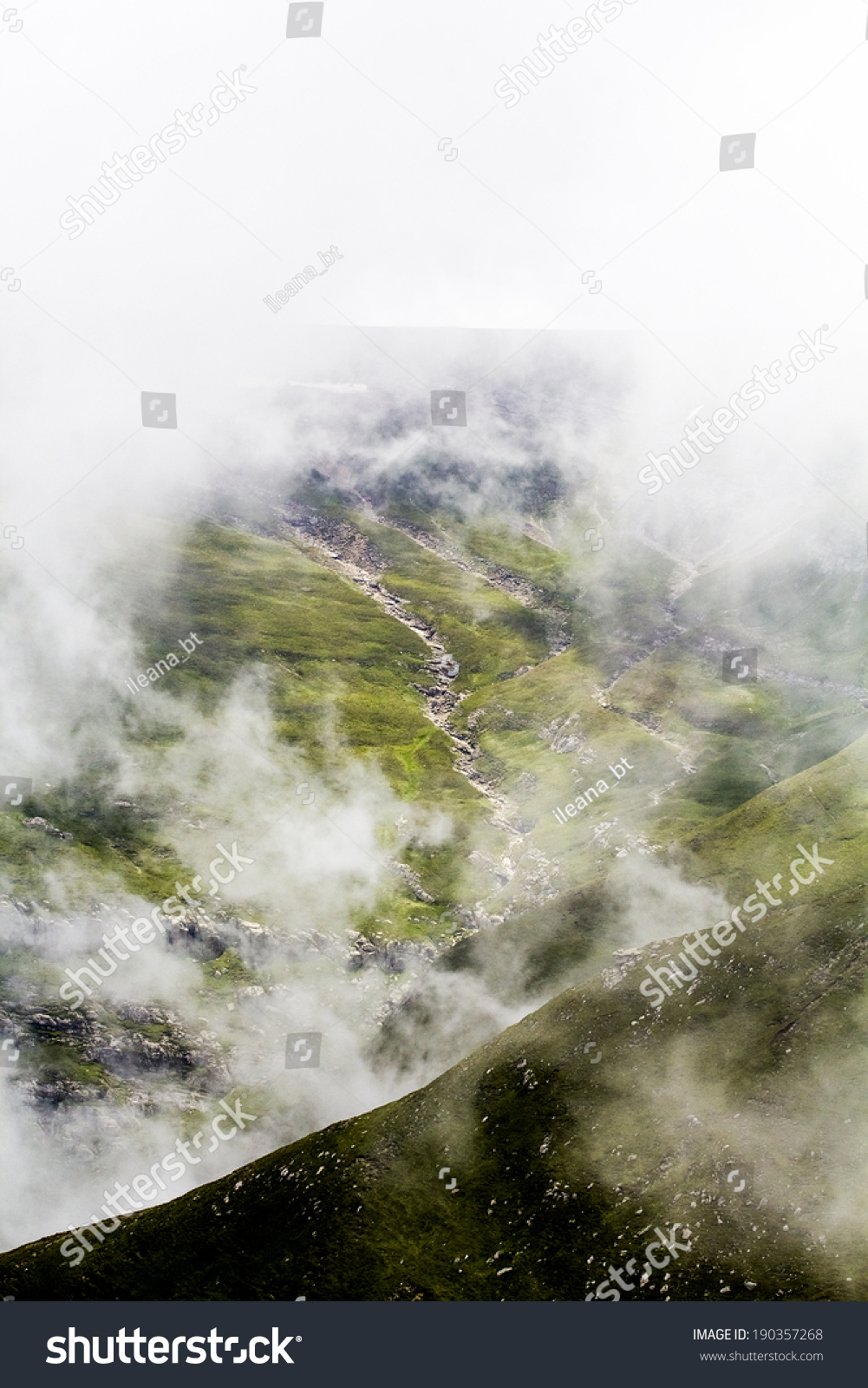 Landscape from Bucegi Mountains, part of Southern Carpathians in Romania in a very foggy day  #190357268