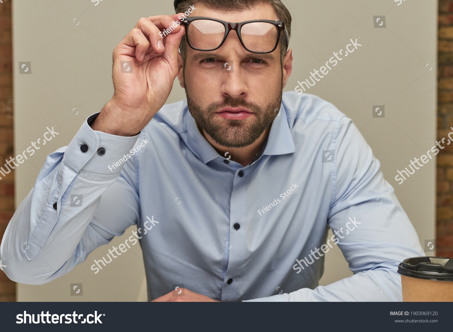 Steadfast glance of the serious office worker #1903969120