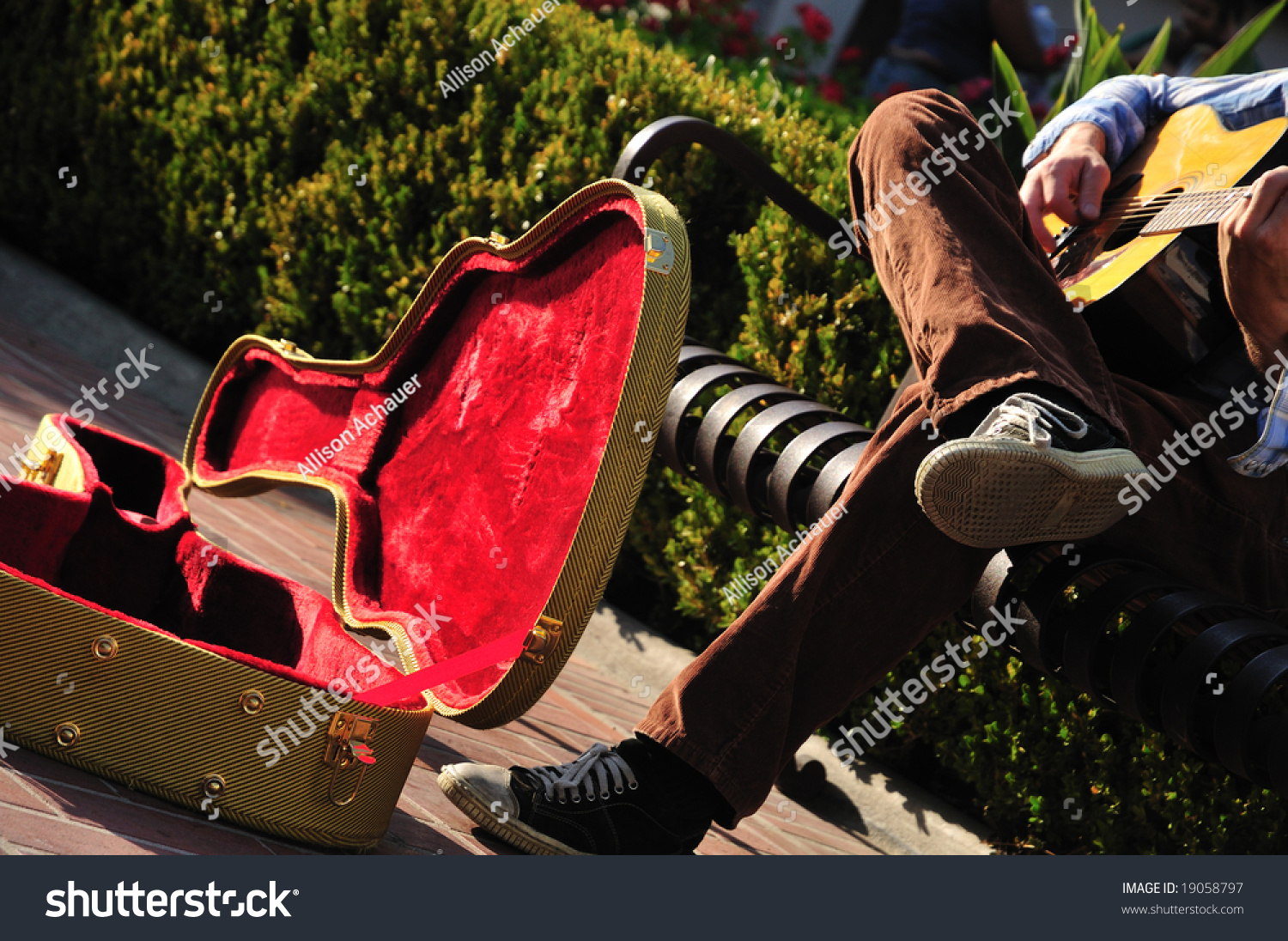 red lined guitar case of a street musician sitting on a bench stock photo 19058797 shutterstock. Black Bedroom Furniture Sets. Home Design Ideas