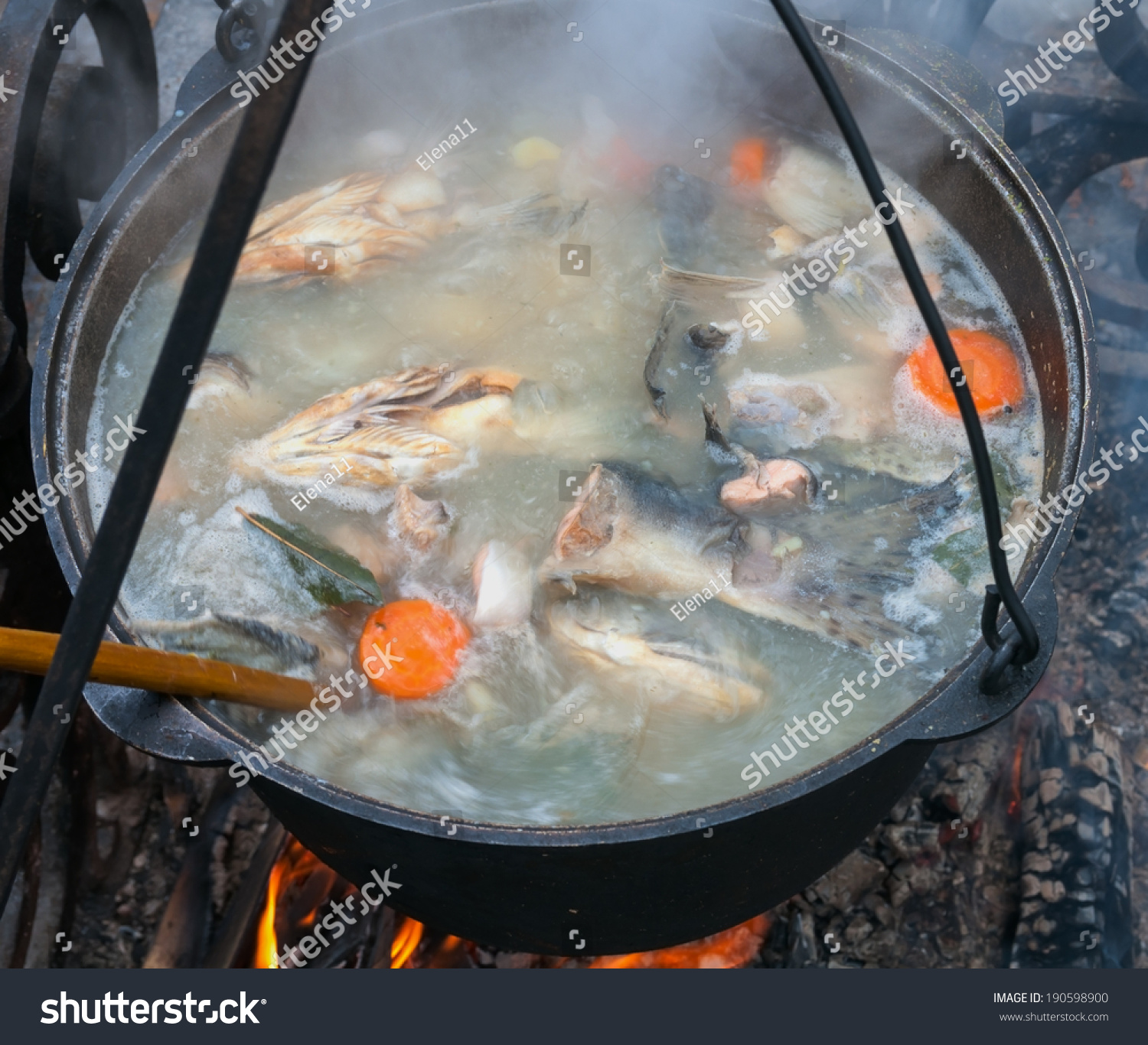Cooking fish soup in a pan on the fire stock photo for Fish on fire