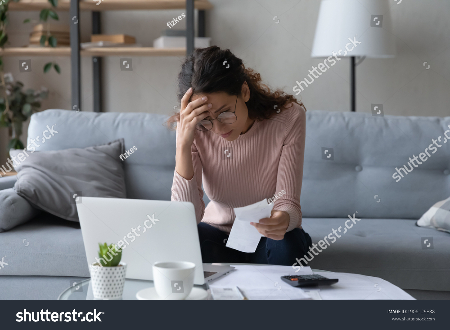 Unhappy young woman in glasses feeling stressed calculating monthly expenses at home, facing financial problems or lack of money for utility household or rental payments, bankruptcy concept. #1906129888