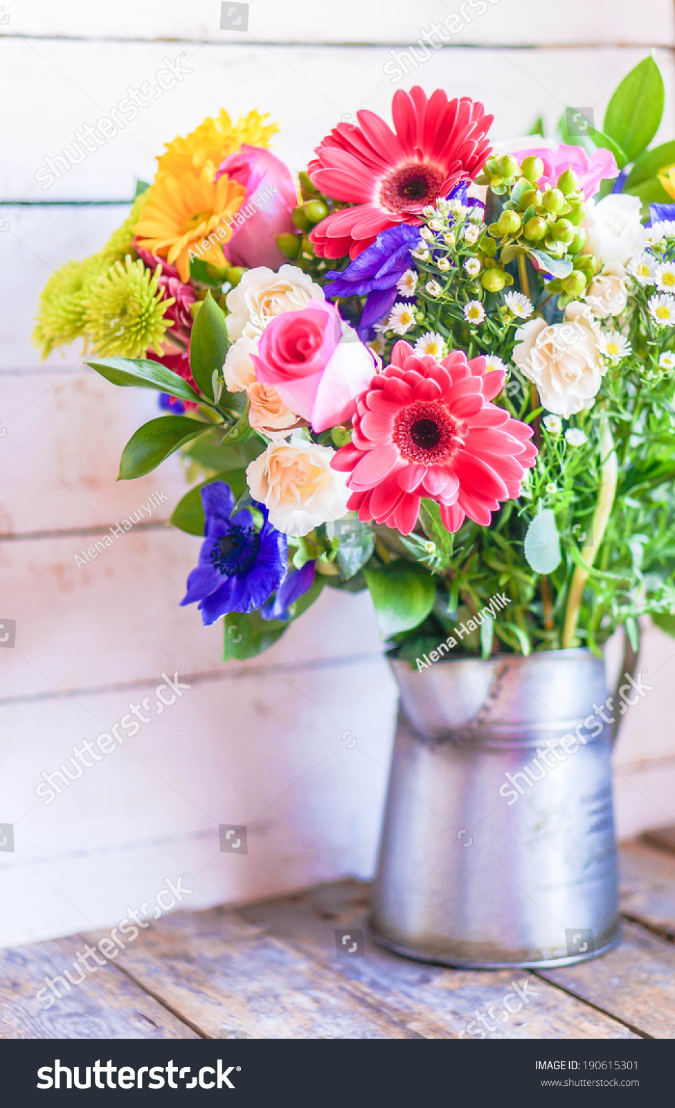 Colorful bouquet of spring flowers in vintage vase on rustic wooden id 190615301 izmirmasajfo