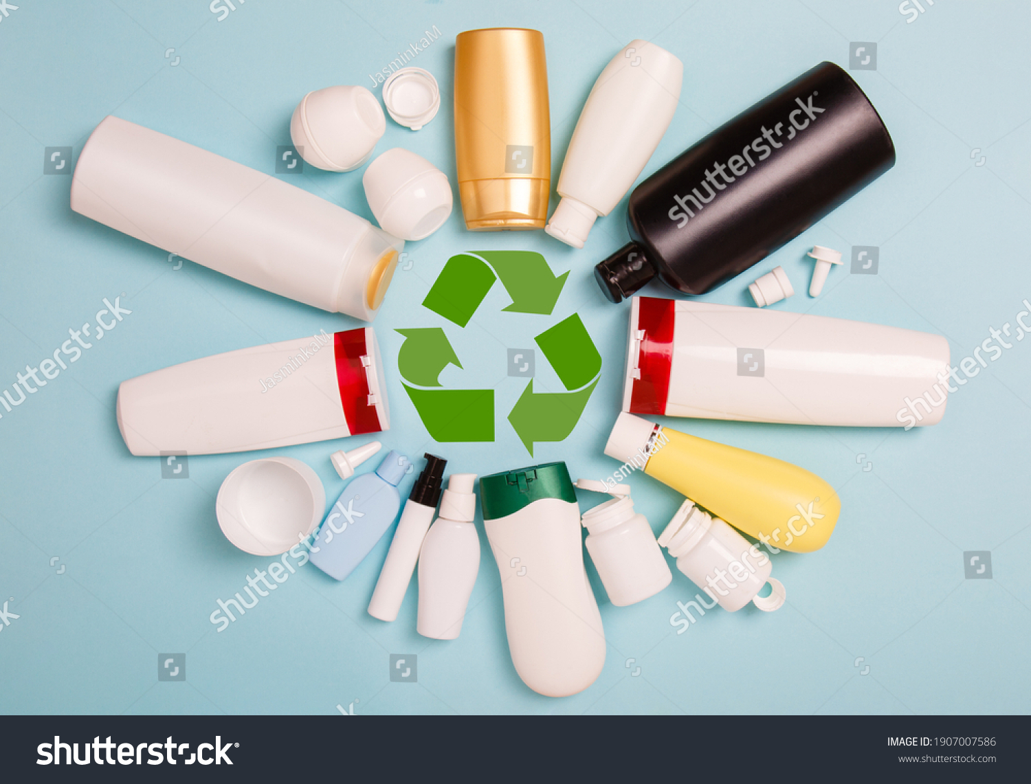 separate collection of sorted HDPE bottles from cosmetics for recycling in for of circle. High-Density Polyethylene recyclable cosmetics package on blue background. Plastic garbage. Save the planet #1907007586