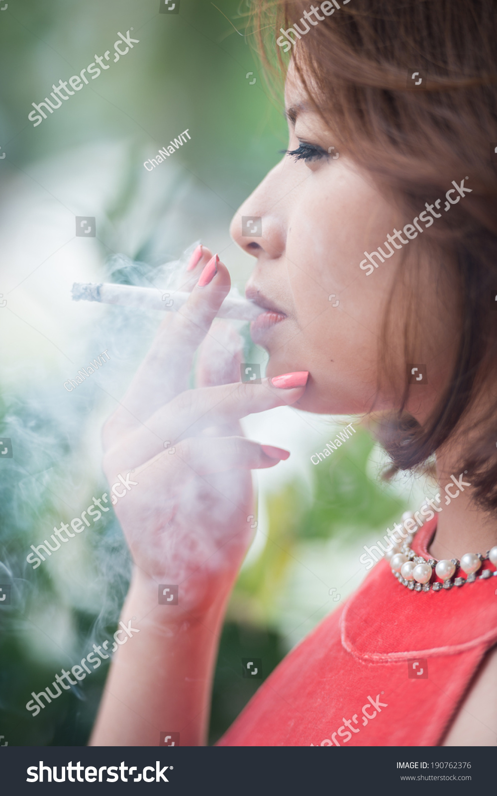http://image.shutterstock.com/z/stock-photo-young-asian-woman-smoking-cigarette-190762376.jpg
