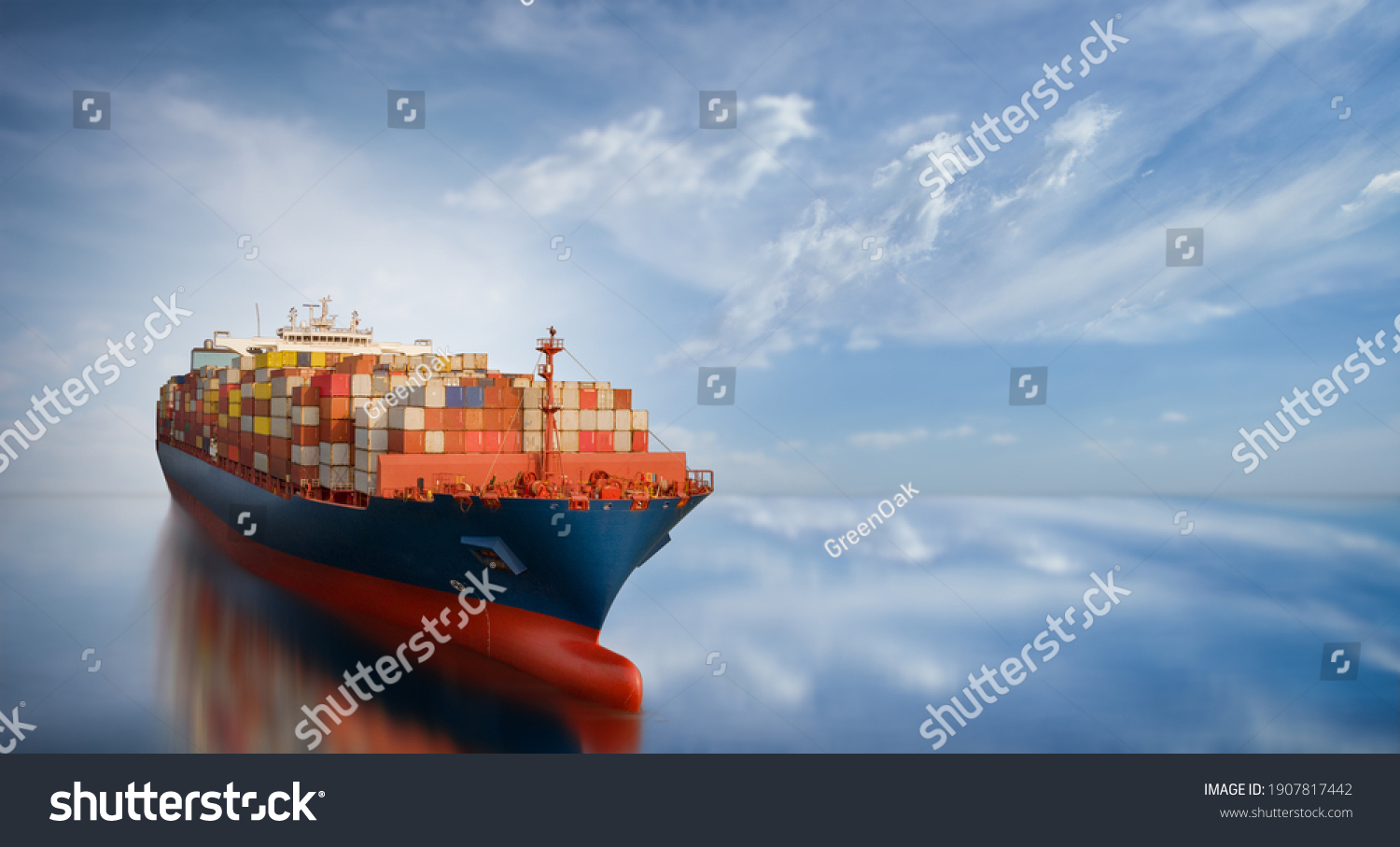 Aerial side view of smart cargo ship carrying container from custom container depot go to ocean concept freight shipping by ship service on blue sky background. #1907817442