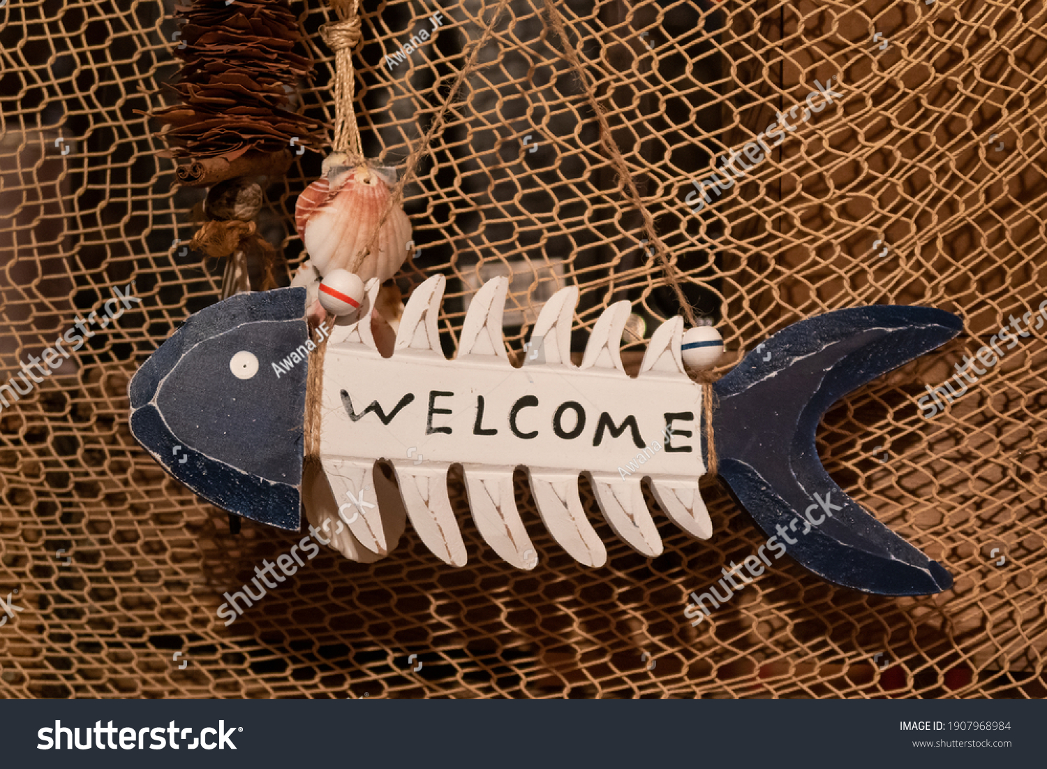 stock-photo-welcome-sign-on-a-wooden-dec