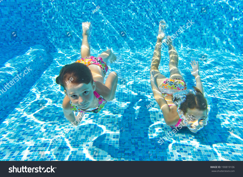 happy kids swim underwater in pool and having fun children on summer vacation sport - Kids Swimming Underwater