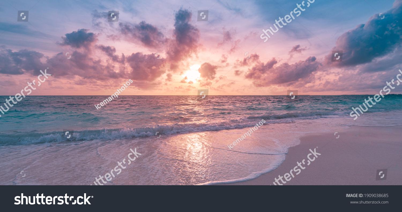 Closeup sea sand beach. Panoramic beach landscape. Inspire tropical beach seascape horizon. Orange and golden sunset sky calmness tranquil relaxing sunlight summer mood. Vacation travel holiday banner #1909038685