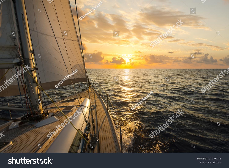 Sailboat sailing in the Mediterranean Sea at sunset #1910102716