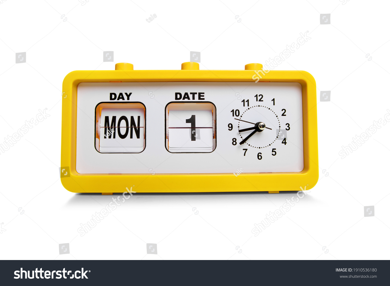 Retro electronic alarm clock and analog flip calendar. Retro design from 60s 70s home interior. Bright yellow color #1910536180