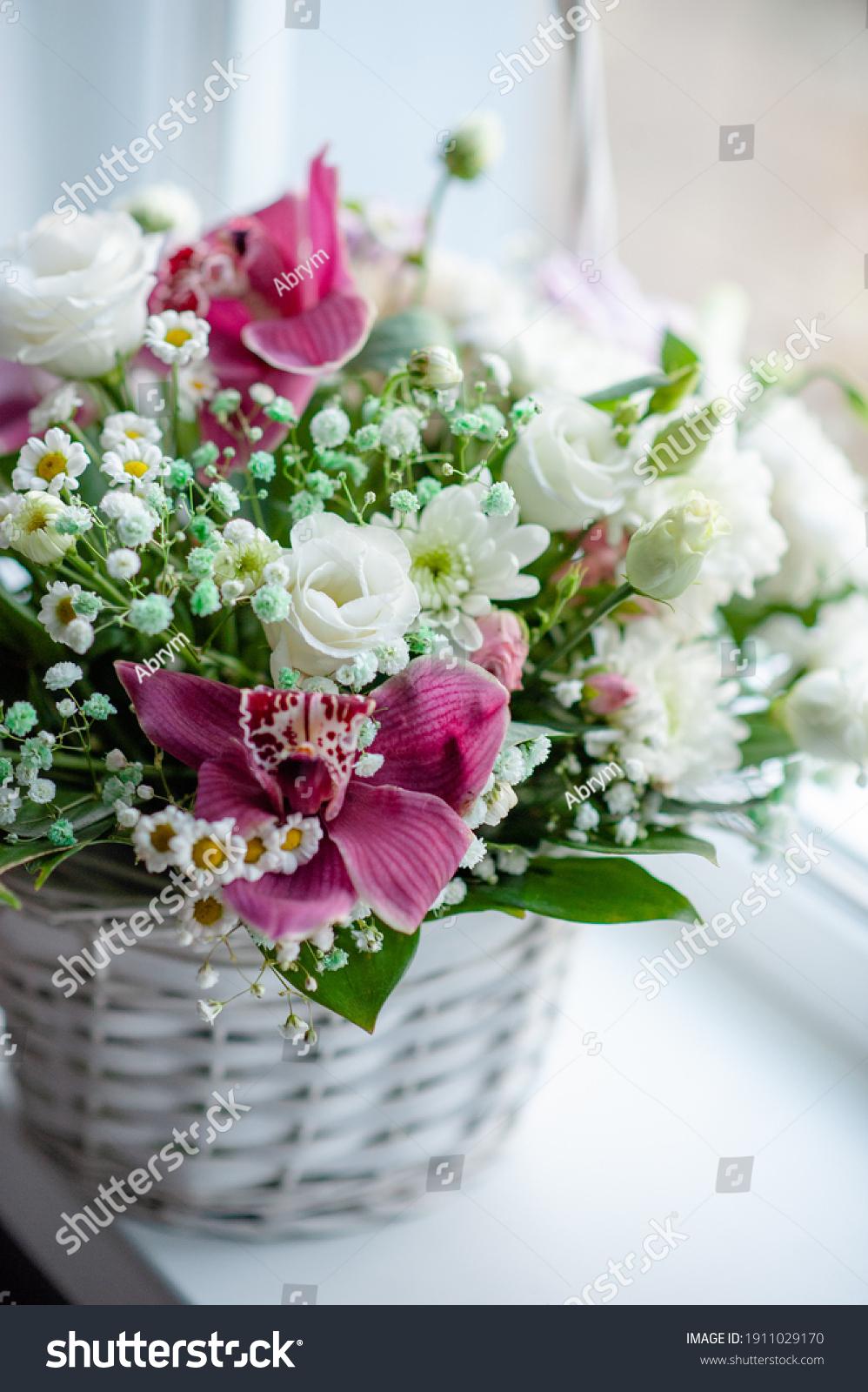 Delicate spring flower arrangement in a wicker basket. Flower arrangement for woman #1911029170