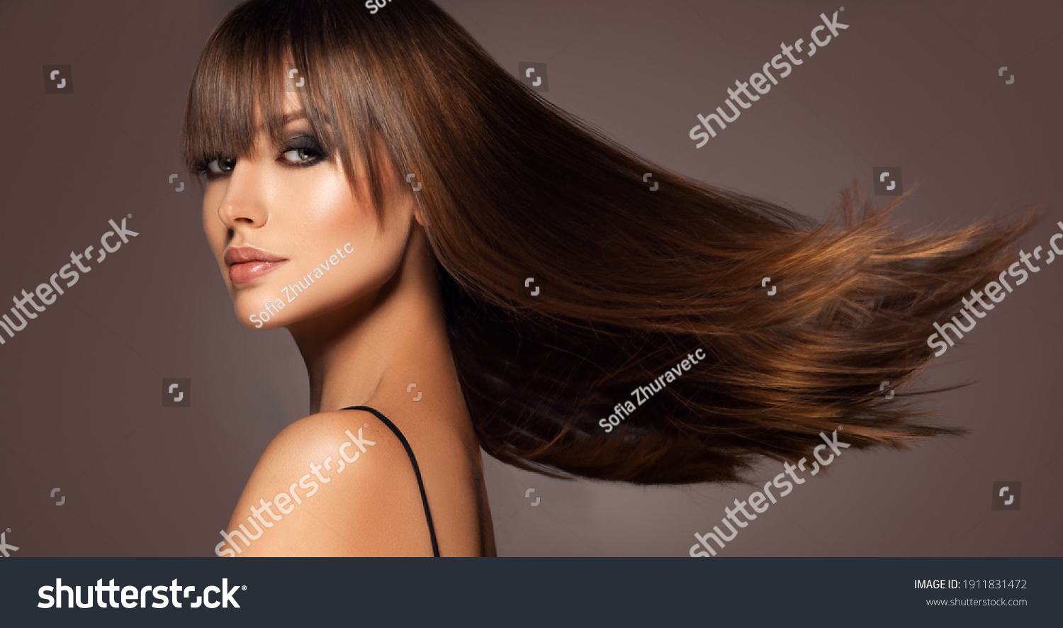 Beautiful model woman with shiny  and straight long hair. Keratin  straightening. Treatment, care and spa procedures. Beauty  girl smooth hairstyle #1911831472