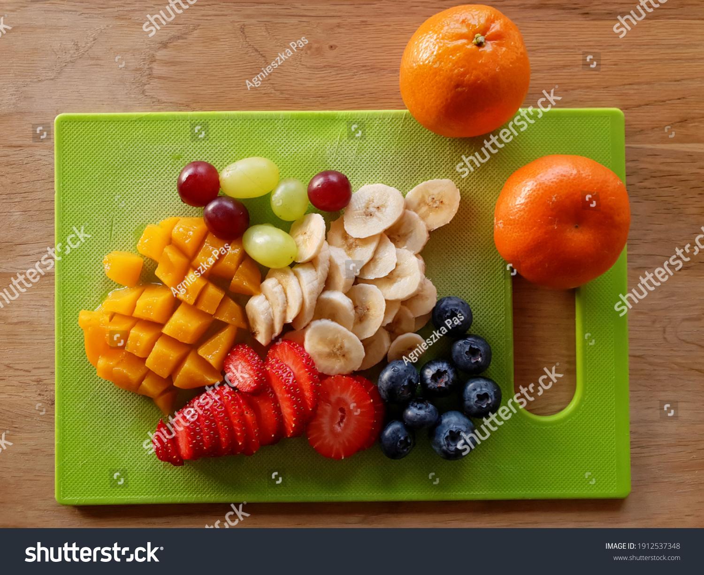 stock-photo-sliced-fruits-on-cutting-boa