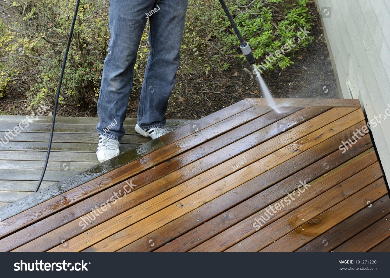 Power washing a deck - Man Power Washing Deck