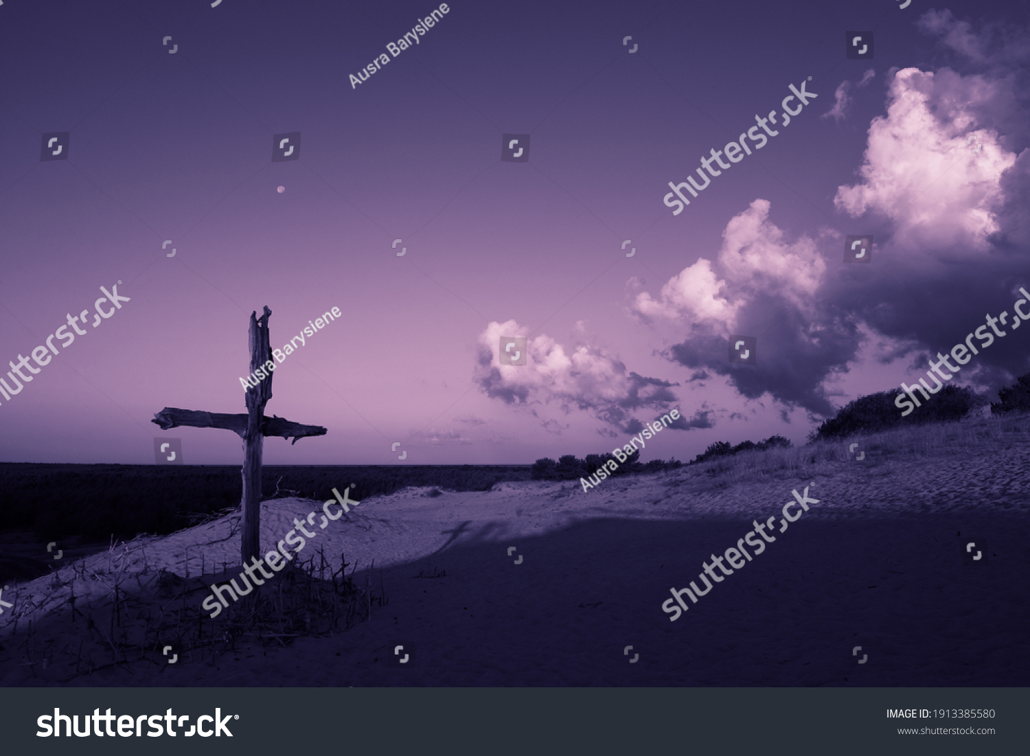 Purple landscape with wooden Cross or crucifix.  Concept for Lent Season, Holy Week, Palm Sunday and Good Friday. #1913385580