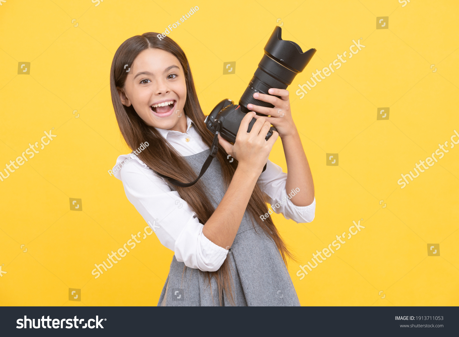 pure happiness. hobby or career. photographer beginner with modern camera. making video. childhood. teen girl taking photo. kid use digital camera. happy child photographing. school of photography. #1913711053