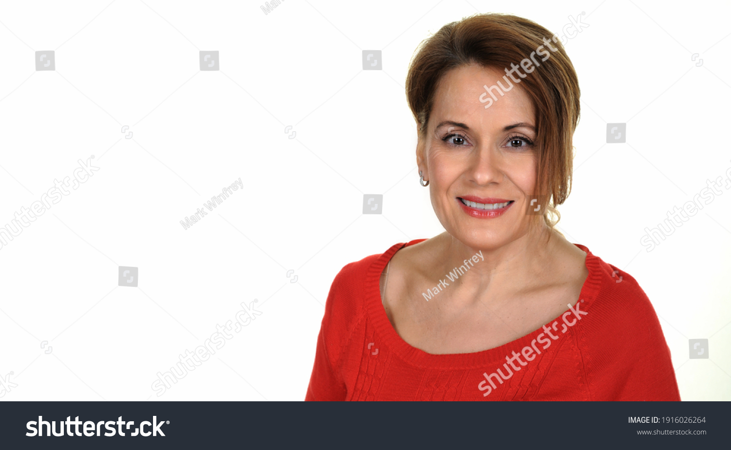 Portrait of a Beautiful Mature Woman in a Red Sweater