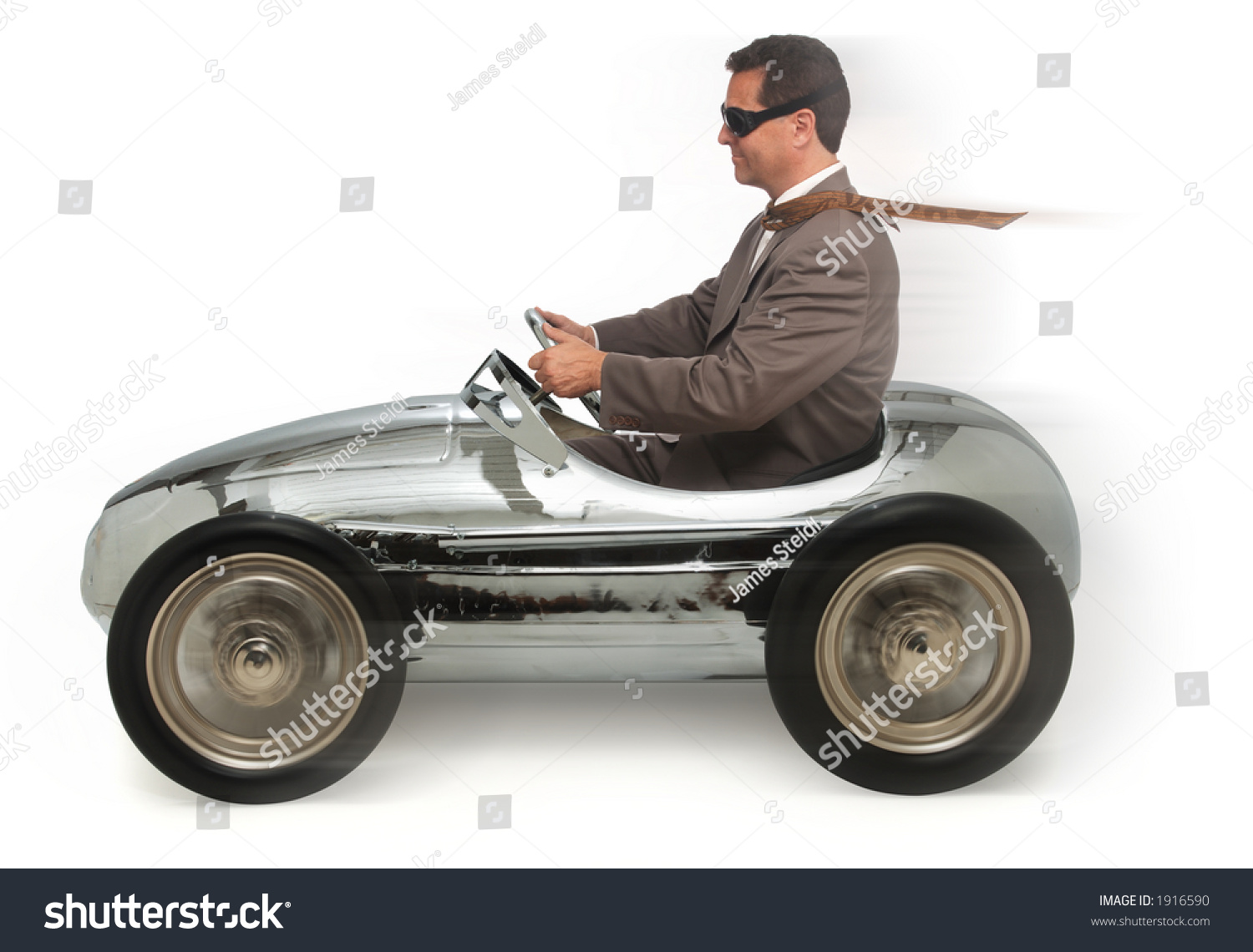 Adult Pedal Car: Adult Man In Child'S Pedal Car On White Background Stock