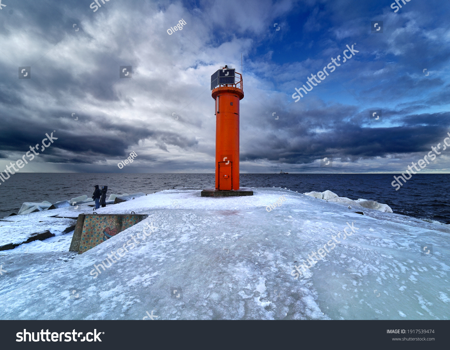 Winter on shore of the Baltic Sea. Lighthouse in ice #1917539474