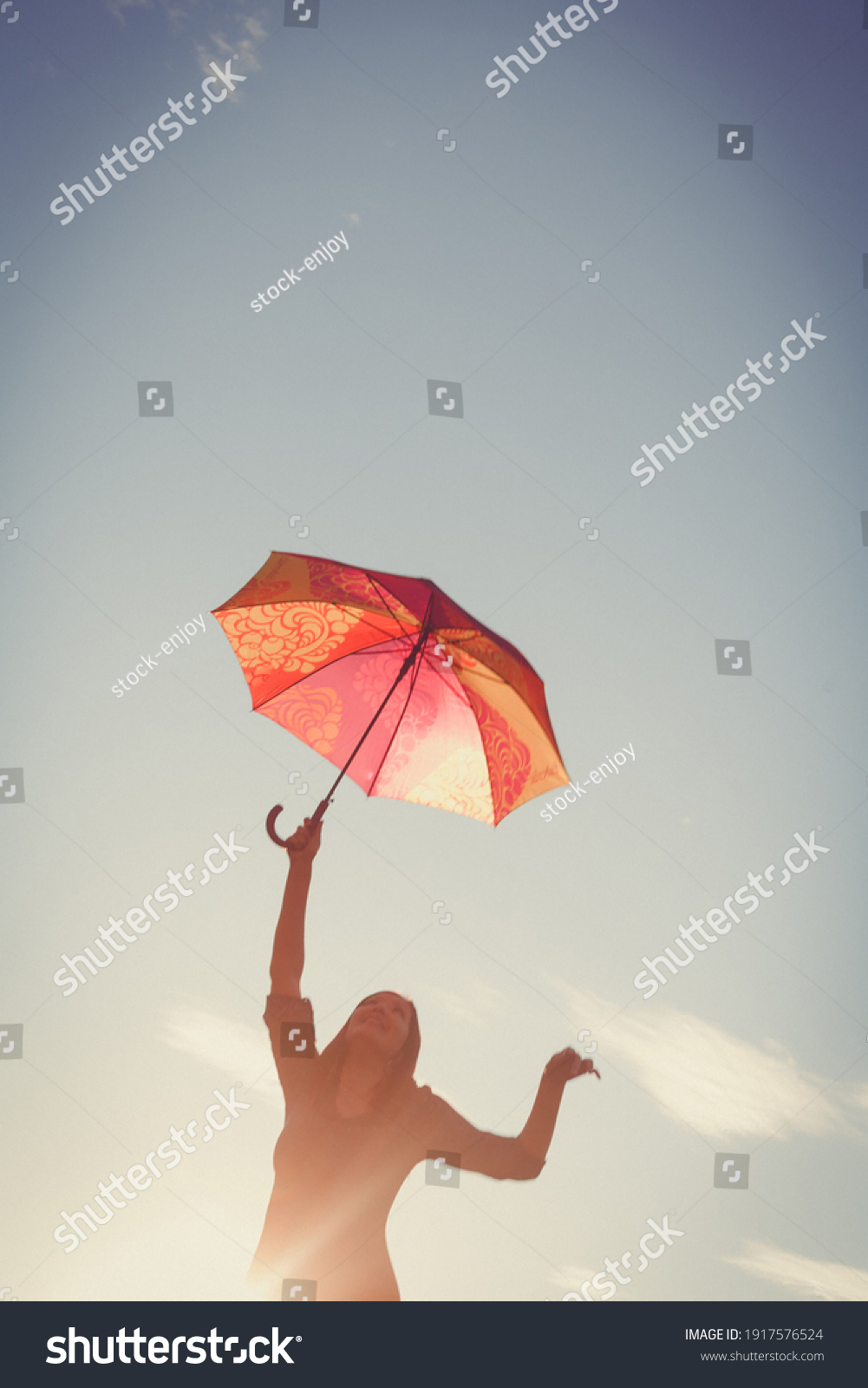 stock-photo-the-girl-dances-with-an-umbr
