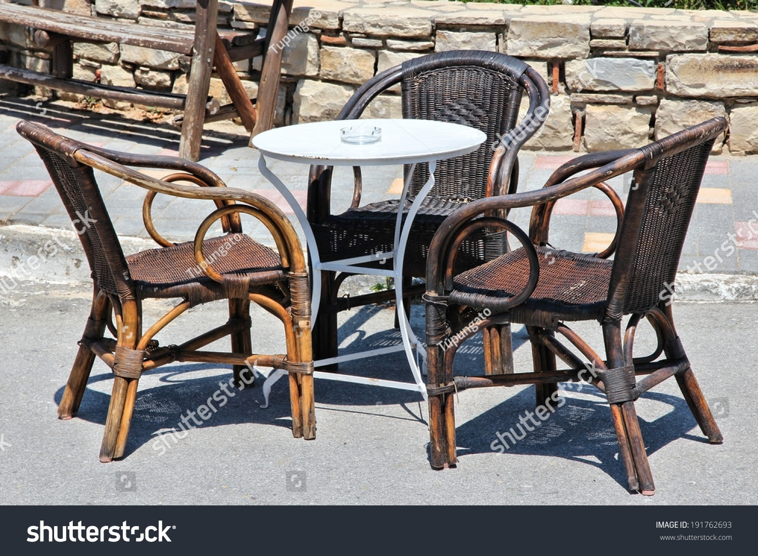 Restaurant table and old rattan chairs in athens greece