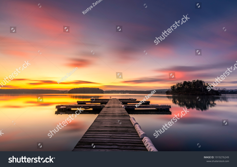 Sunset lake pier landscape view #1919276249
