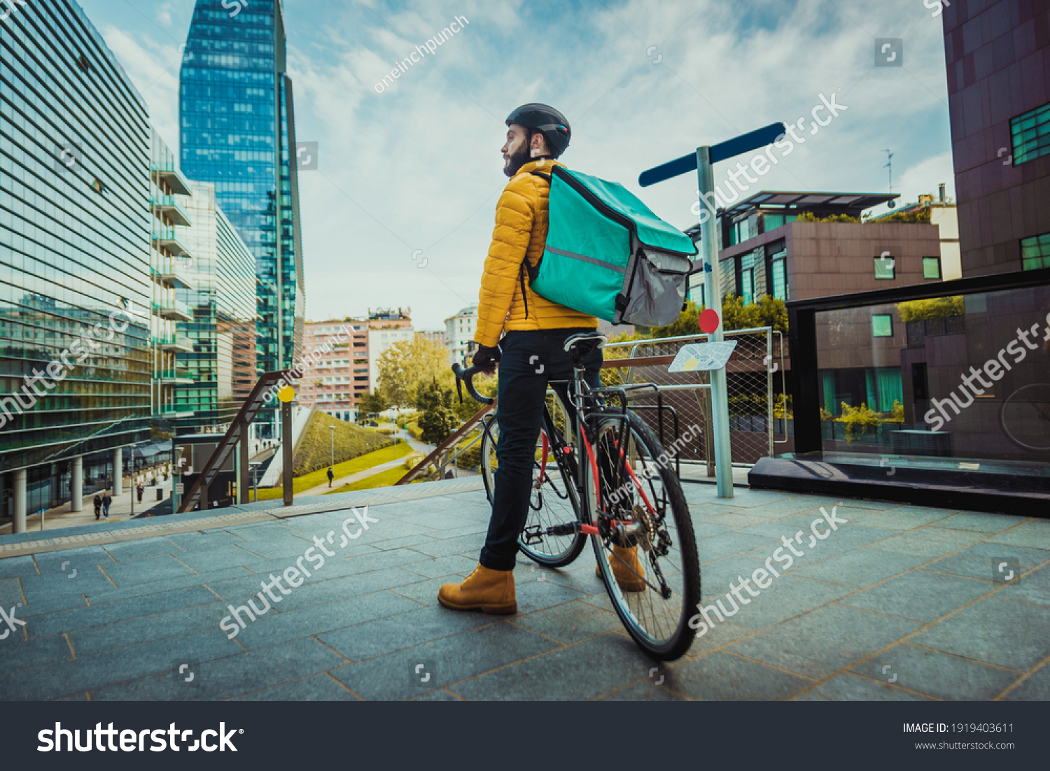 Food delivery service, rider delivering food to clients with bicycle - Concepts about transportation, food delivery and technology #1919403611