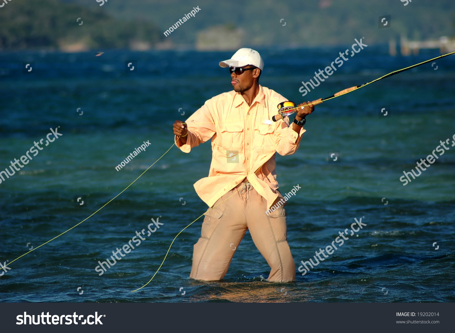 Fishing guide honduras shows concentration while stock for Fly fishing shows