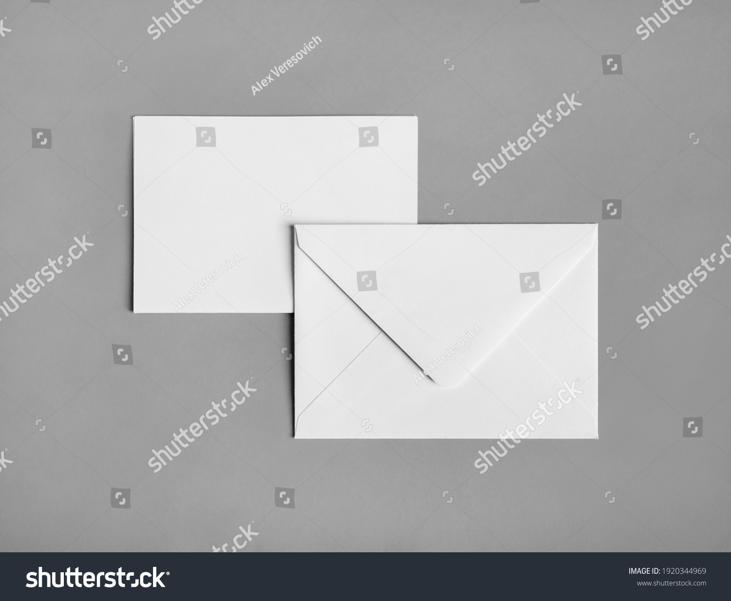 Two blank paper envelopes on gray paper background. Back and front. Flat lay. #1920344969