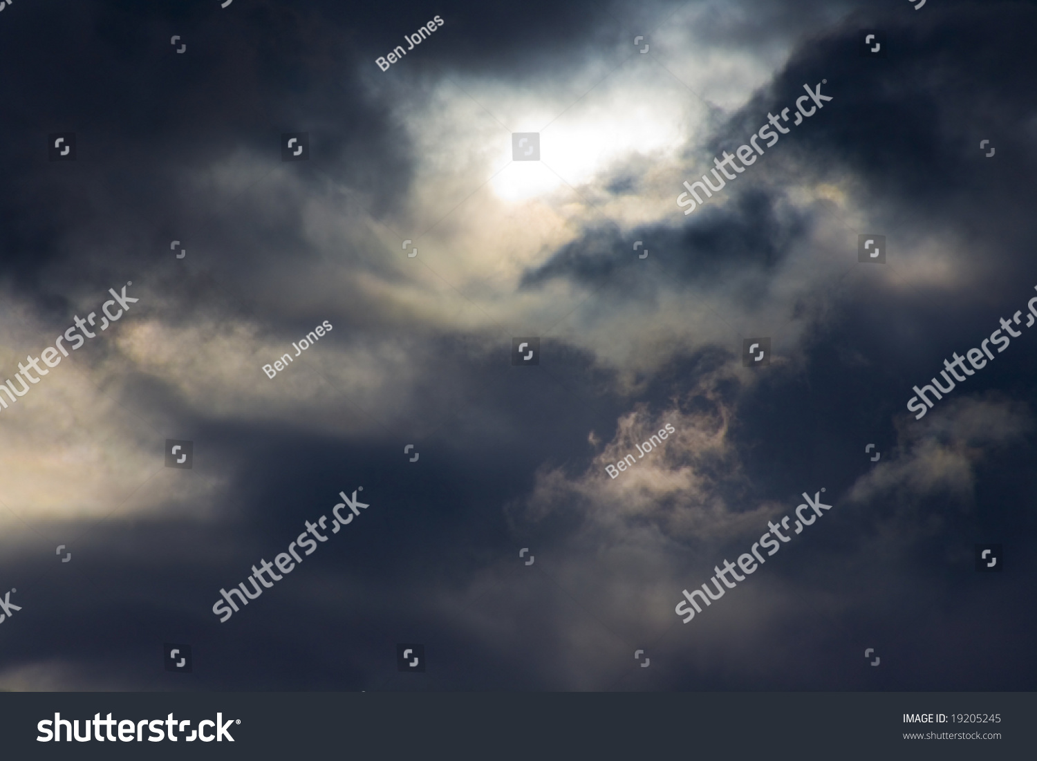 Turbulent Dark Storm Clouds Sun Shining Stock Photo