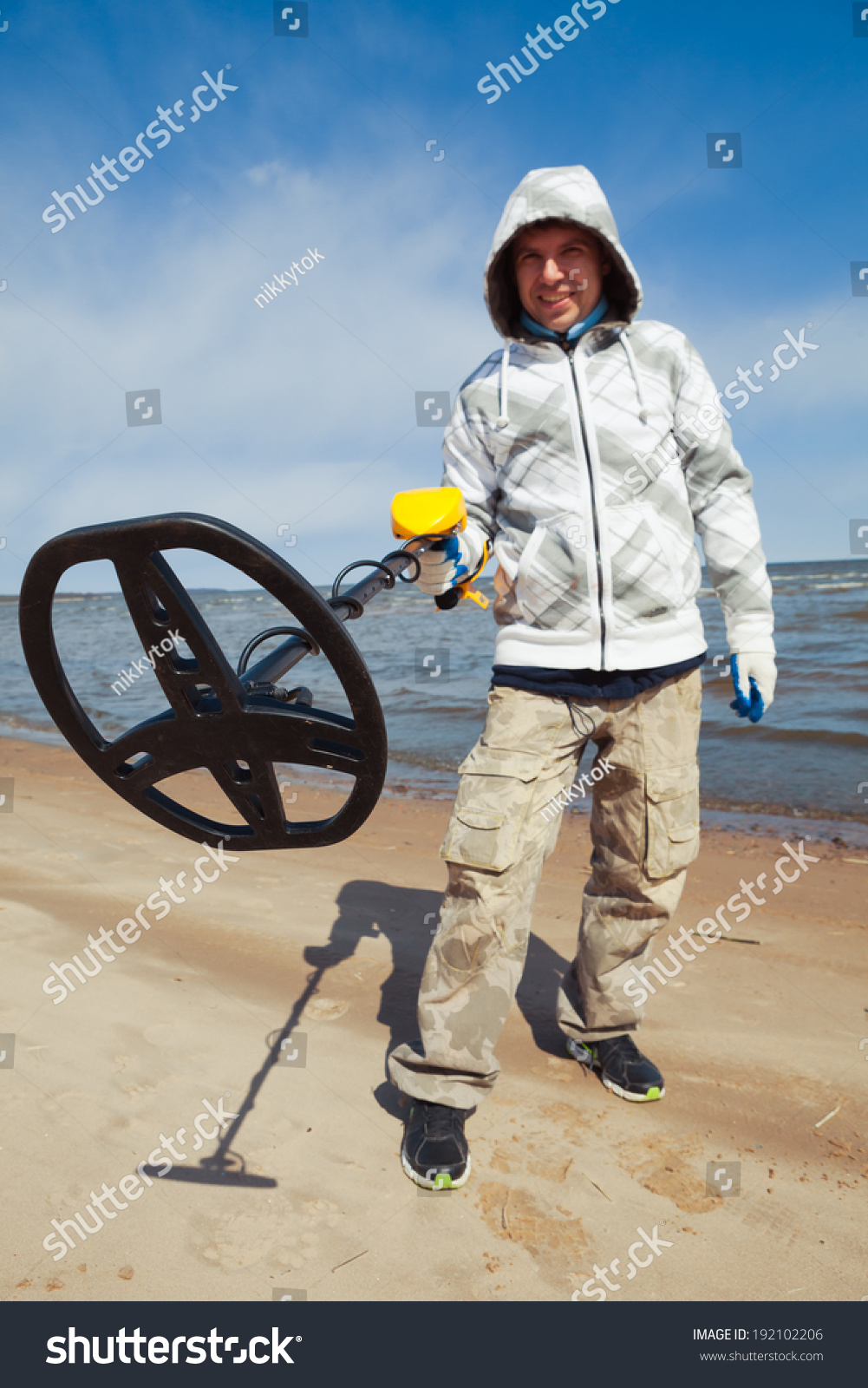 Jew Detector: Man Using Metal Detector Stock Photo 192102206