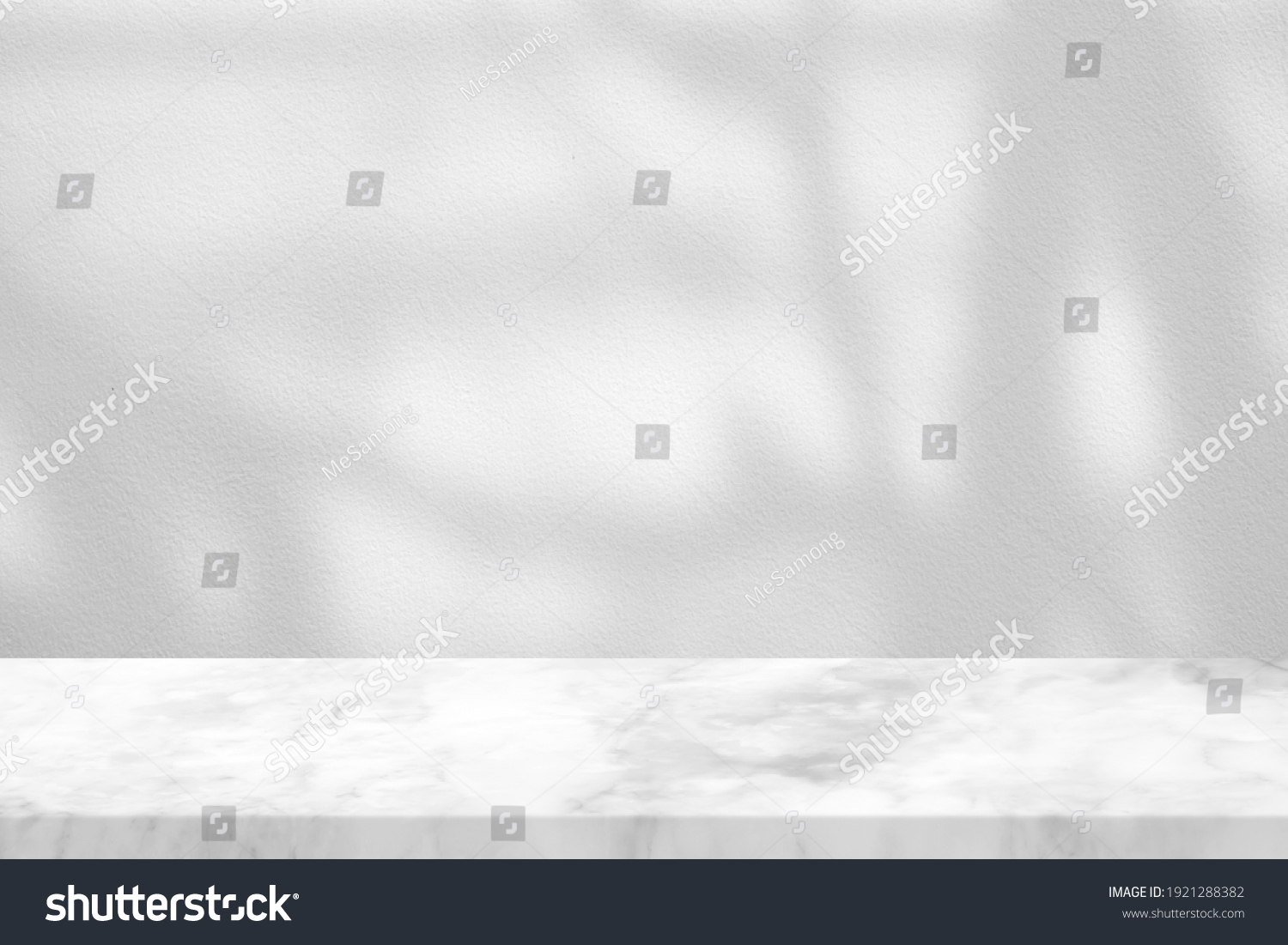 White Marble Table with Tree Branch Shadow on Concrete Wall Texture Background, Suitable for Product Presentation Backdrop, Display, and Mock up. #1921288382